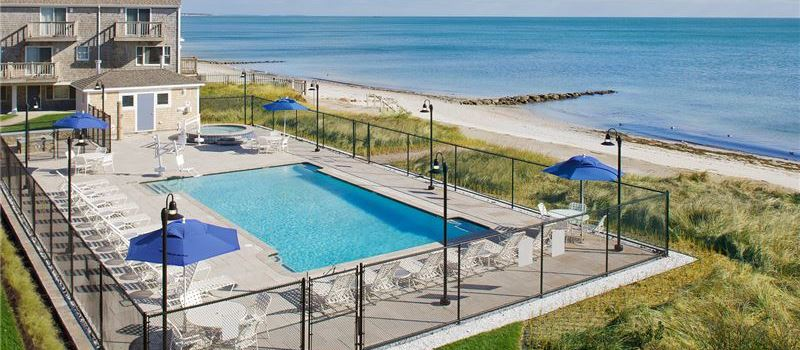 Outdoor Pool, Hot Tub and Firepit at Ocean Mist Beach Hotel & Suites, Massachusetts